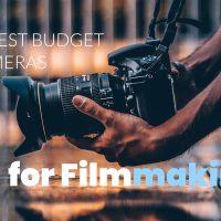 Best budget cameras for filmmaking - man holding camera