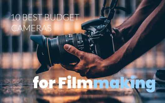 Best budget cameras for filmmaking - man holding camera