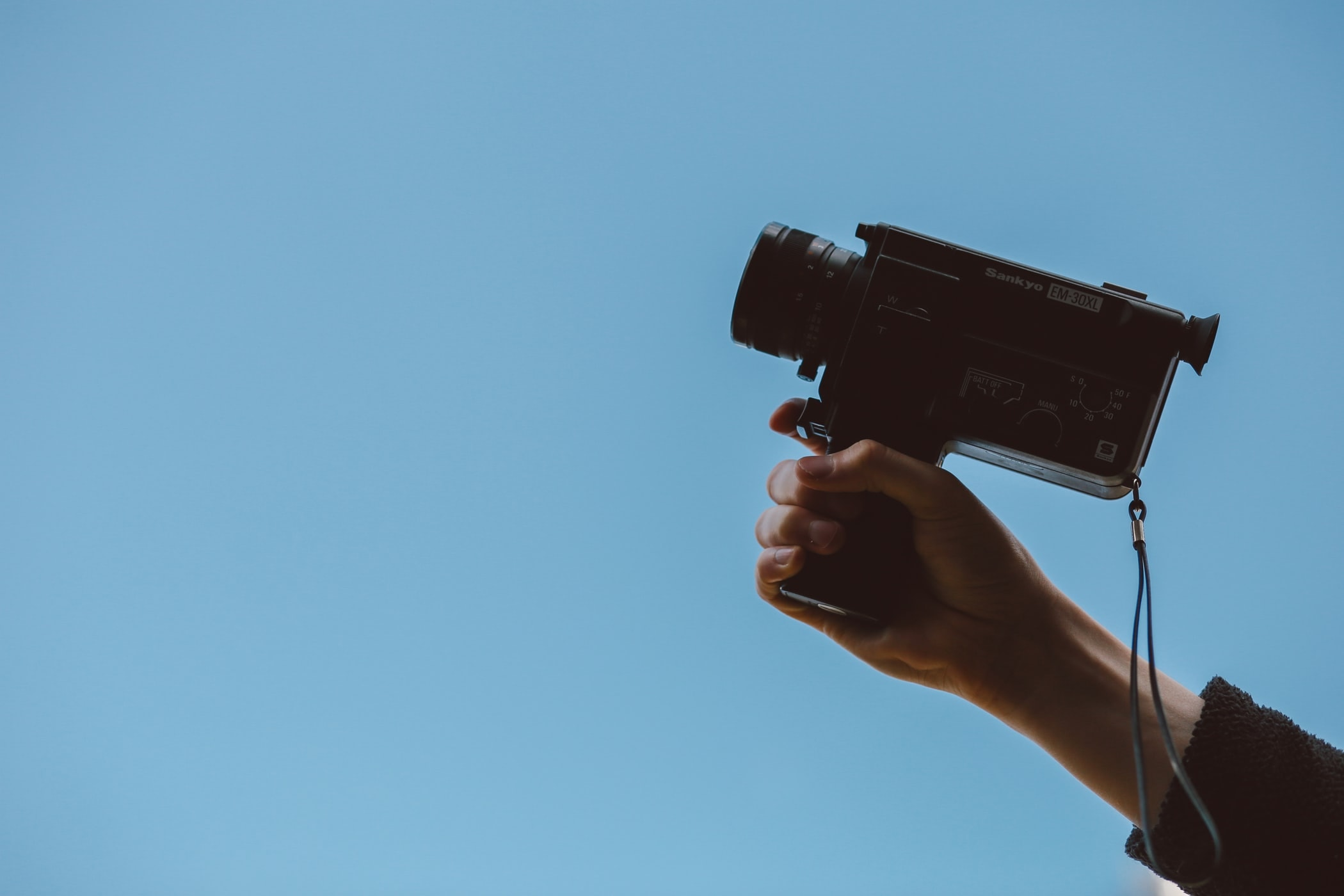 10 Best Budget Cameras For Filmmaking in 2019 - An image of someone holding a vintage camcorder