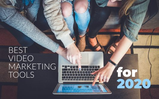 best video marketing tools 2020 - girls pointing at laptop