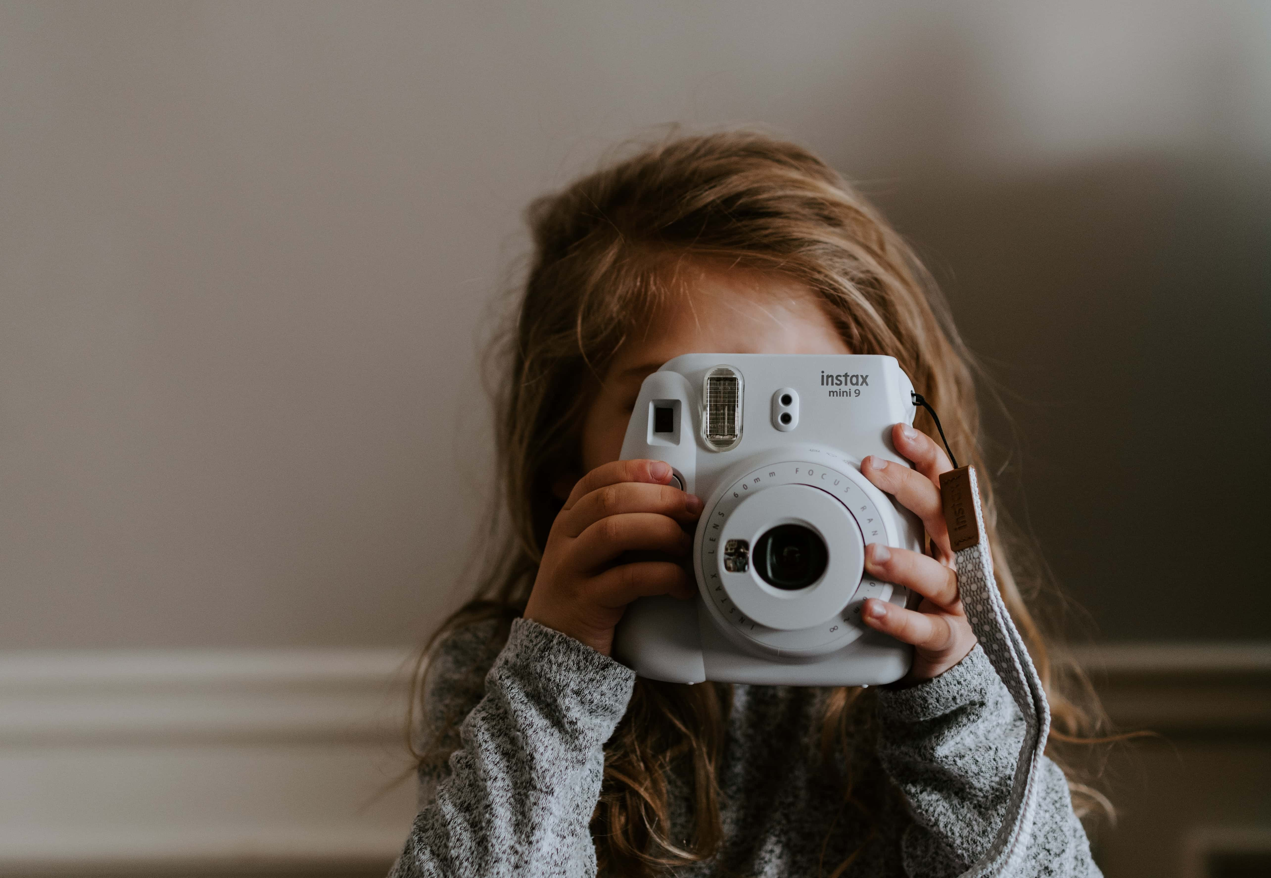 Filmmaking Trends in 2020 - An Image of a Young Child Holding a Camera