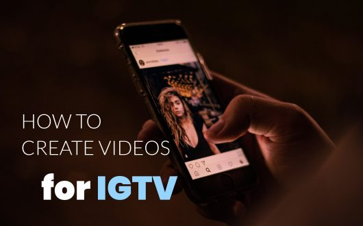 How to Create Videos for IGTV - Man holds smartphone with Instagram app