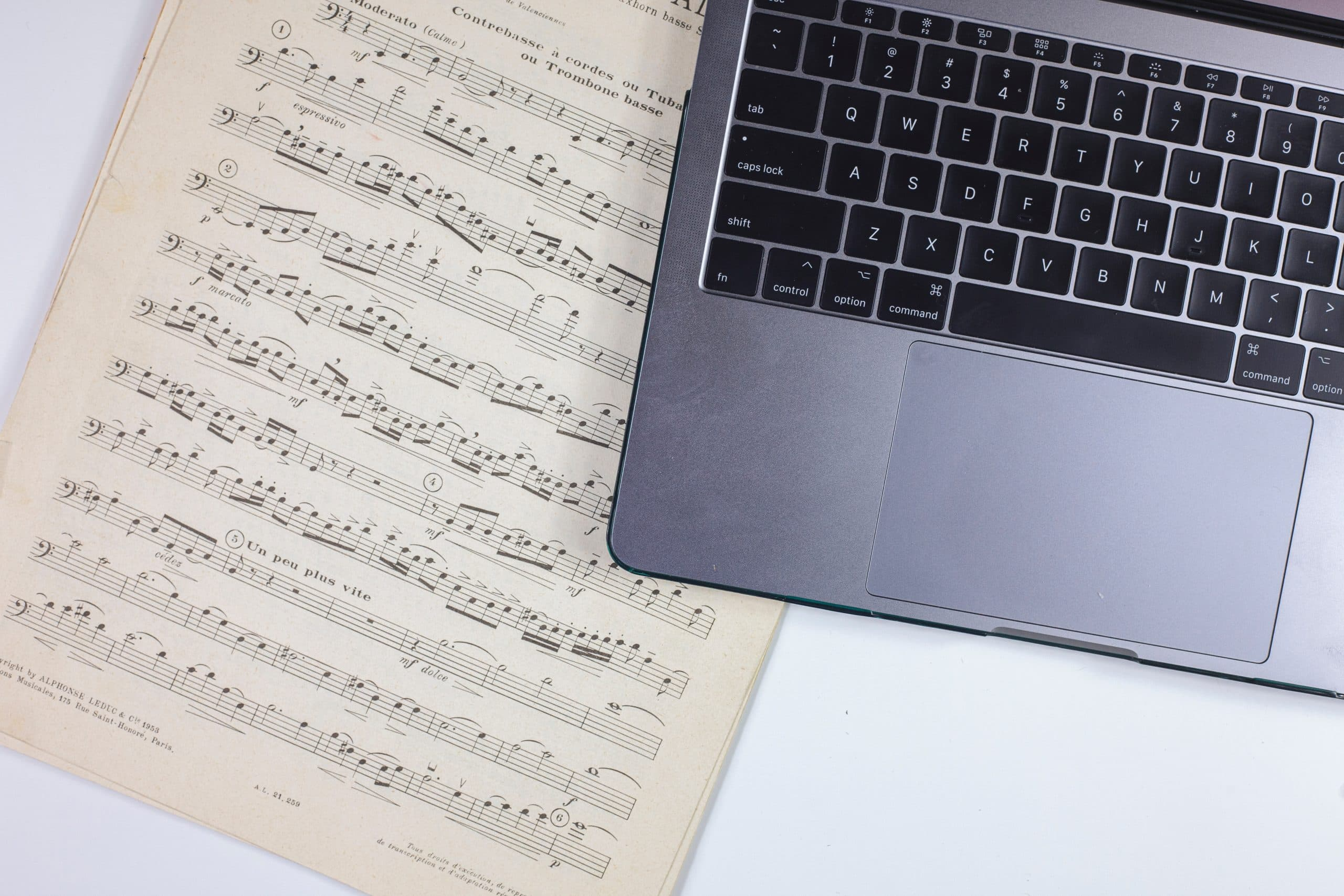 The Best Filmmaking Blogs in 2021 - An image of a musical score next to.a laptop