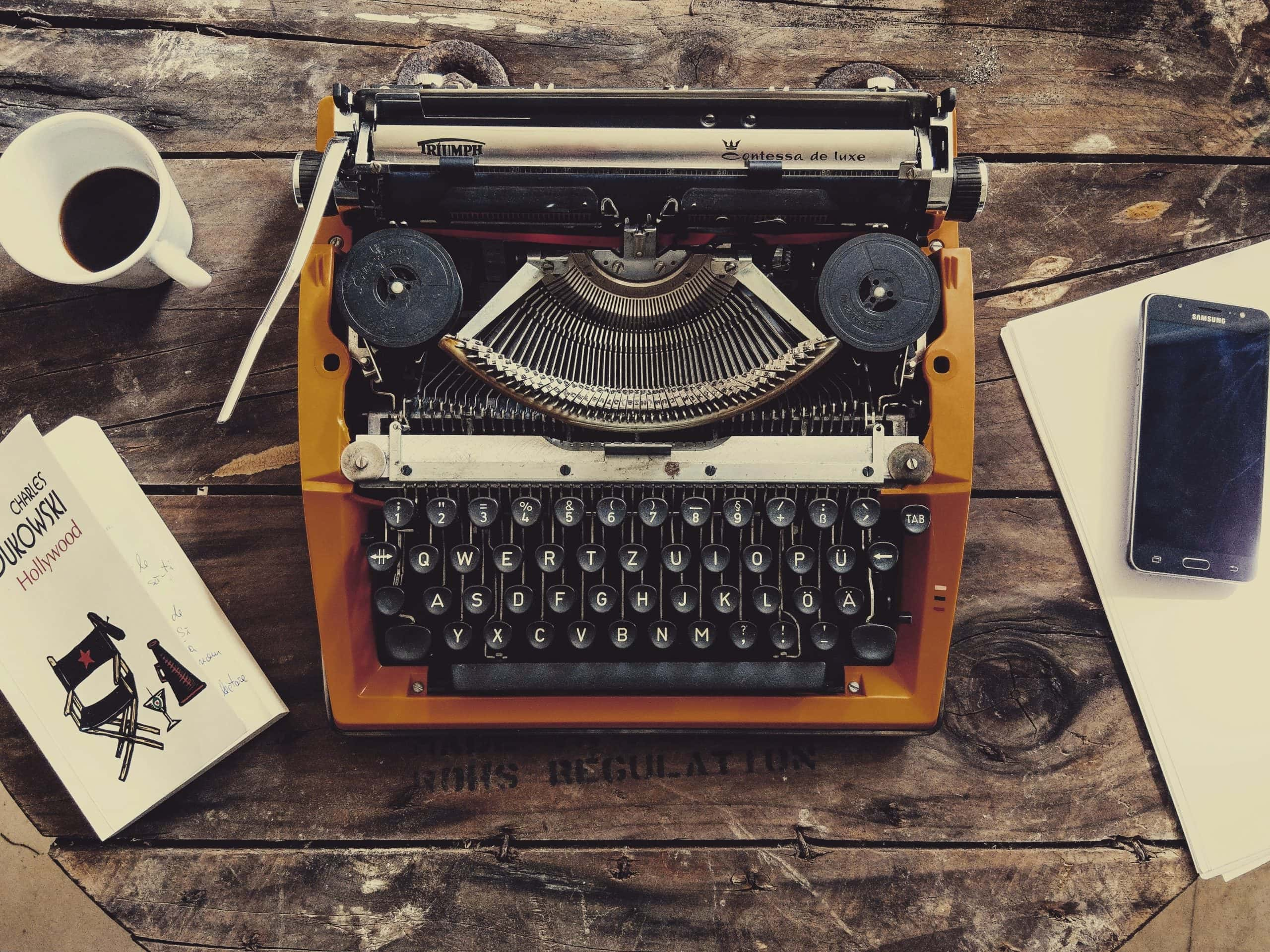 The Best Filmmaking Blogs in 2021 - An image of a typewriter and coffee