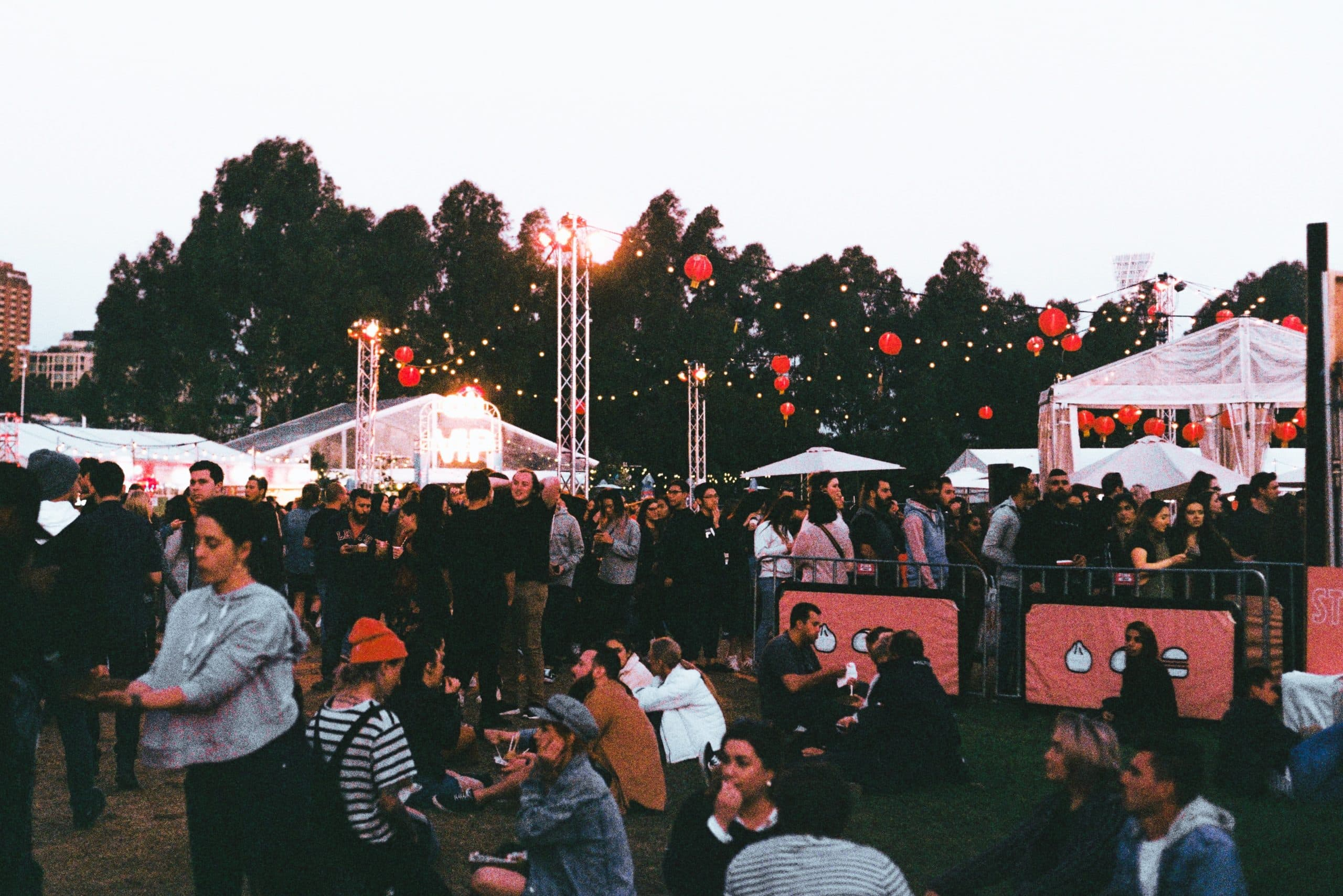 The Best Filmmaking Blogs in 2021 - An image of people sitting on the grass at a festival